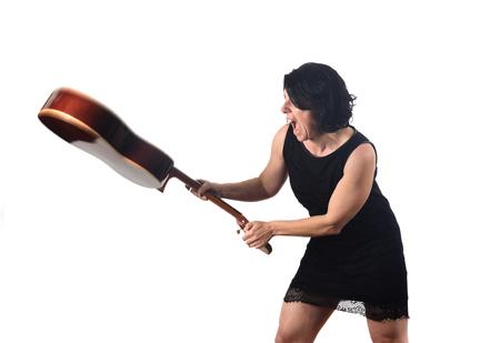 woman break a guitar