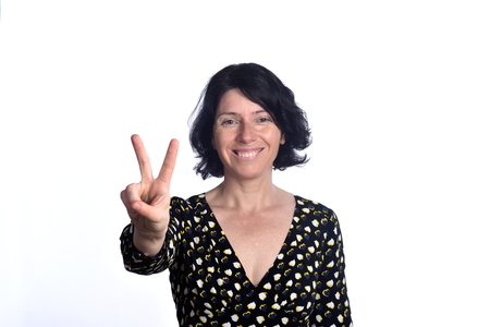 woman with victory sign on white