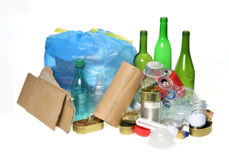 trash for recycling with paper glass bottles, cans, plastic bottle, light bulb