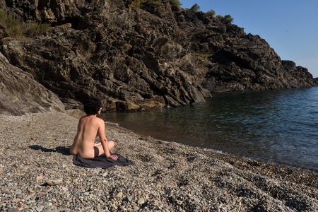 Nudist woman on a beach