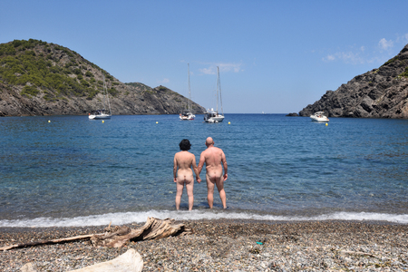 Nudist couple on a beach, Cala Taballera, Cap de Creus, Costa Brava, Girona,Spain