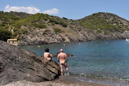 Nudist couple on a beach Stockfoto