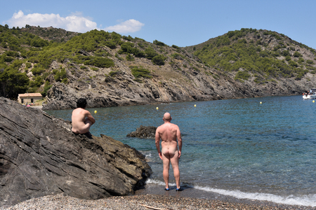 Nudist couple on a beach, Cala Taballera, Cap de Creus, Costa Brava, Girona,Spain