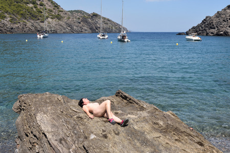 Nudism in Cap de Creus, La Taballera beach, Costa Brava, Girona province, Spain 写真素材