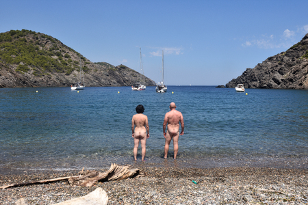 Nudist couple on a beach Stockfoto