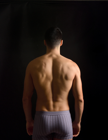 portrait of a man from behind on black background 스톡 콘텐츠
