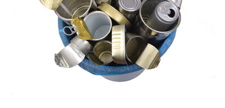 top view of trash can (tin can food and drink) full of cans on white