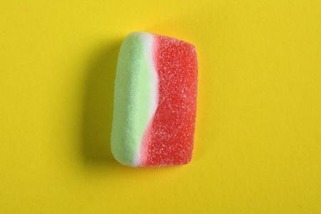 watermelon candy on yellow background Zdjęcie Seryjne