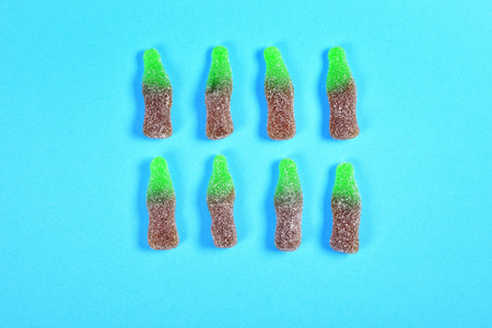 group of jelly candies bottles on blue background