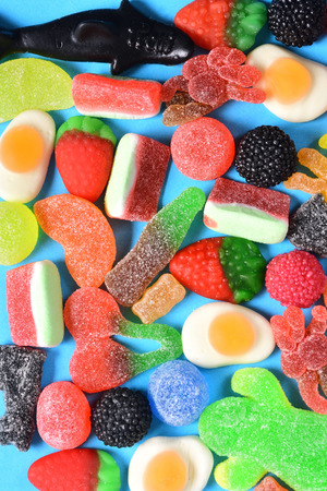 top view of jelly candies collection on blue background
