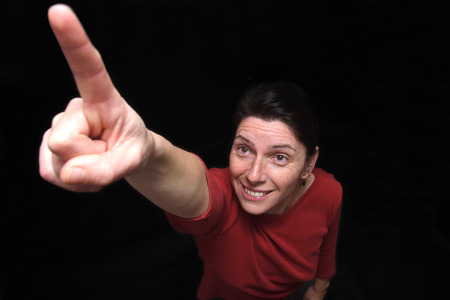 woman pointing on black background