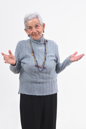 senior woman with open hands on white background