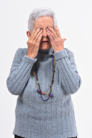 Older woman having her eyes hurt on white background