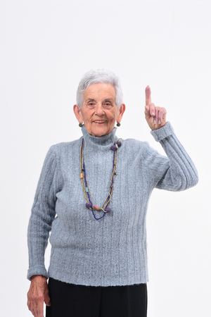 older woman with finger in the shape of number one