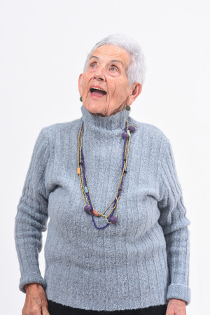 senior woman singing on a white background