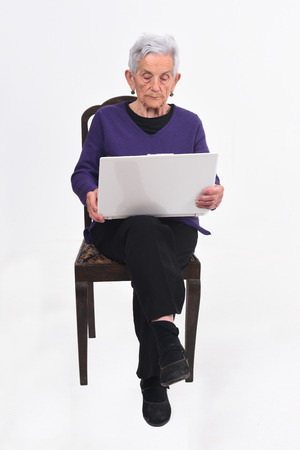 senior woman with laptop on white