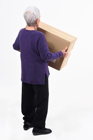 senior woman with package on white background Zdjęcie Seryjne - 127457505
