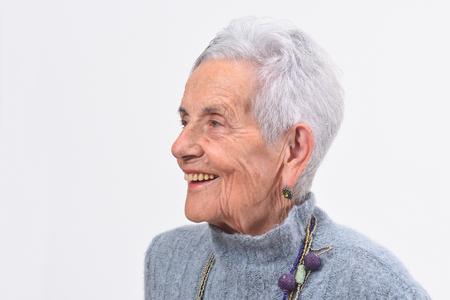 portrait of a senior woman smiling on white background Foto de archivo - 127457529