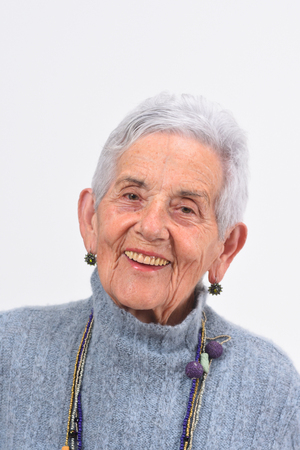 portrait of a senior woman smiling on white background Zdjęcie Seryjne - 127457532