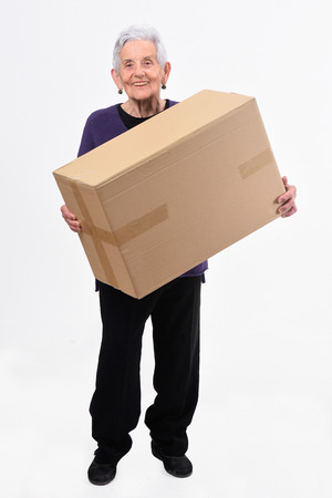 senior woman with package on white background Zdjęcie Seryjne - 127457735
