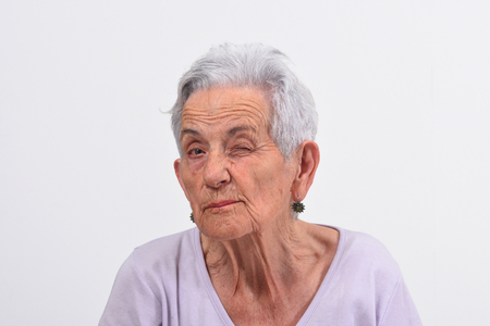 senior woman wink the eye on white background