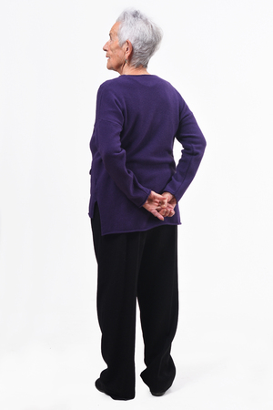 full portrait of an older womans backs with the crossed fathoms on white background