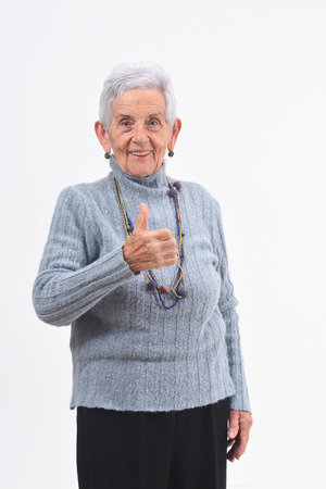 senior woman thumps up on white background Zdjęcie Seryjne