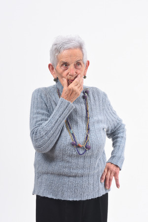 senior woman having doubts and questions on white background