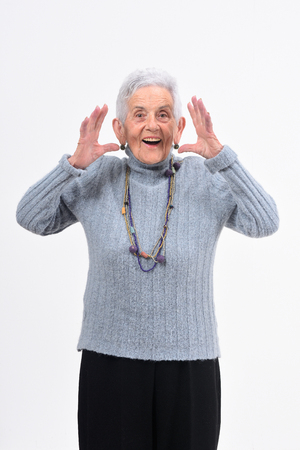 senior woman with expression of forgetfulness or surprise on white background Stock Photo