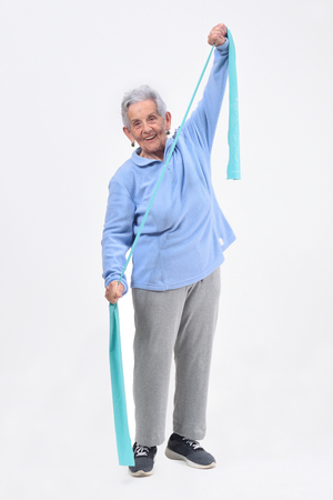 senior woman exercising on white background