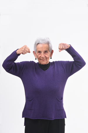 senior woman doing strength on a white background