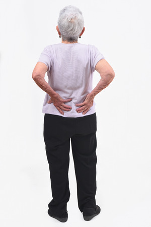 full portrait of the back of an older woman with pain in the back on white background Zdjęcie Seryjne