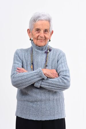 senior woman with arms crossed on white background