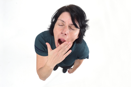 woman yawning on white background