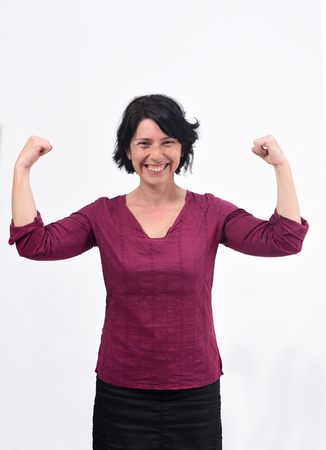 woman raising her arms and smiling in victory sign on white background Zdjęcie Seryjne