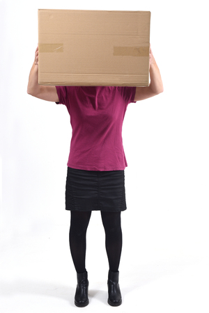 woman with a package in front of her face
