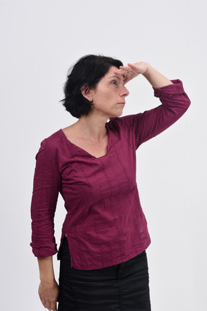 woman with hand in front looking away on white background