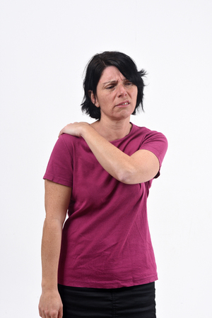 woman with pain on shoulder on white background Stock Photo