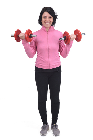 middle-aged woman with dumbbells on white background