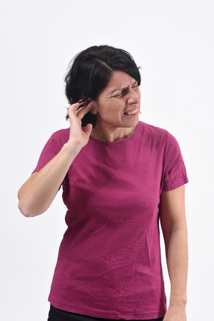 woman with pain on ear on white background