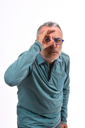 man looking through fingers as if wearing glasses on white background Banco de Imagens