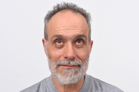portrait of a man looking up on white background
