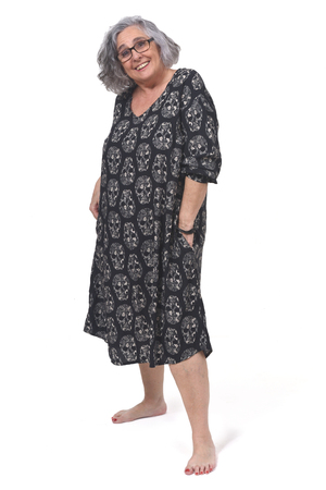 full portrait of a womna with dress and barefoot on white background