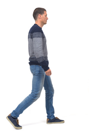 full portrait of a middle age man walking with jeans on white 版權商用圖片