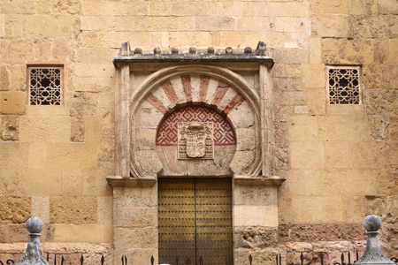 Door and facade San Miguel, Moorish facade of the Great Mosque in Cordoba, Andalusia, Spain