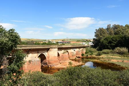 Roman bridge and Rio Tinto in Niebla village, Huelva province, Andalusia, Spain Stock Photo
