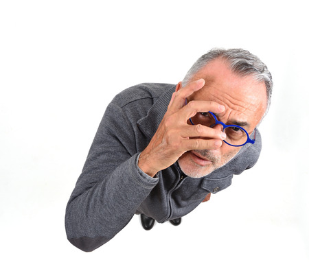 man peeking with hand on face on white background