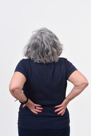portrait of senior woman with pain back on white Standard-Bild - 122803053