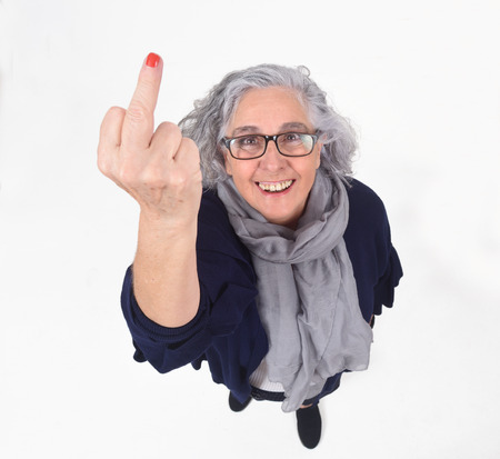 Woman who lifts on middle finger in a rude way