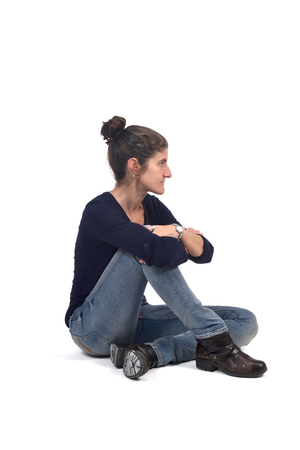 full portrait of woman sitting in the floor on white